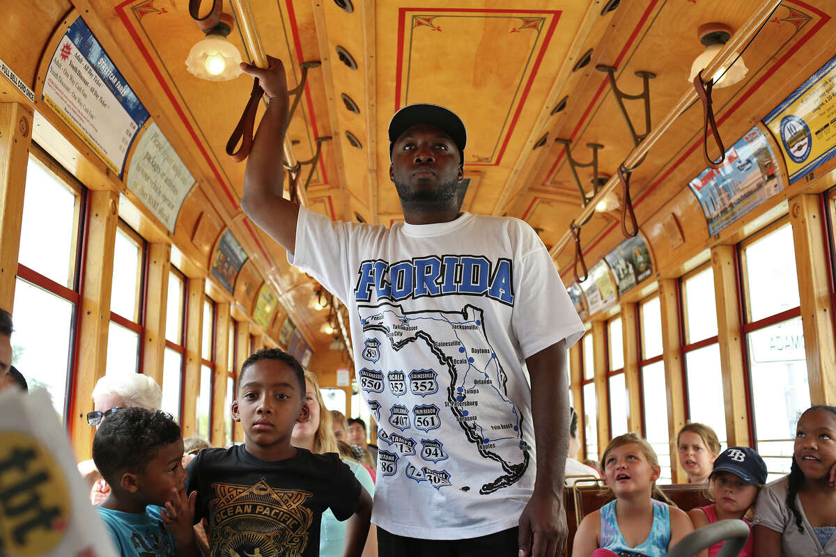 Devon Simpson, of San Diego, CA, rides the TECO Line Streetcar with his family including sons, Malik Simpson, 6, from left, and Savion Simpson, 7, in Tampa, FL on July 11, 2013.