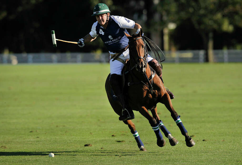 Peter Brant shoots and scores for the Royal Salute team during the second annual Royal Salute Jubilee Cup at the Greenwich Polo Club on Sunday, Sept. 8, 2013. Photo: Jason Rearick / Stamford Advocate