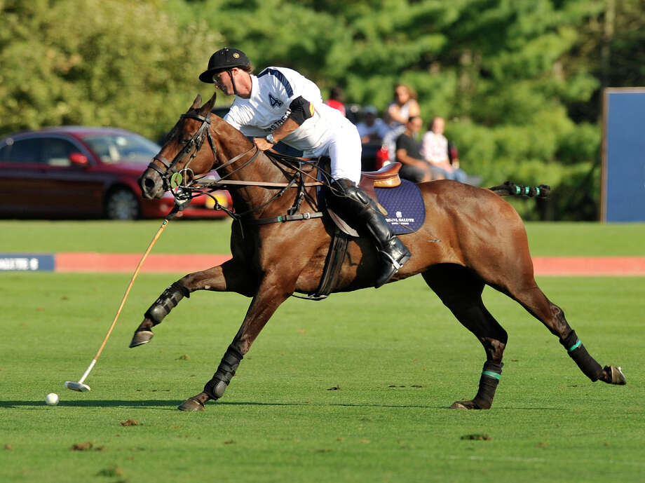 Airstream's Nick Manifold hits the ball down the field during the second annual Royal Salute Jubilee Cup at the Greenwich Polo Club on Sunday, Sept. 8, 2013. Photo: Jason Rearick / Stamford Advocate
