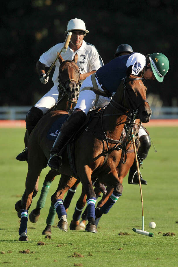 Royal Salute's Peter Brant is trailed by Airstream's Matias Magrini during the second annual Royal Salute Jubilee Cup at the Greenwich Polo Club on Sunday, Sept. 8, 2013. Photo: Jason Rearick / Stamford Advocate