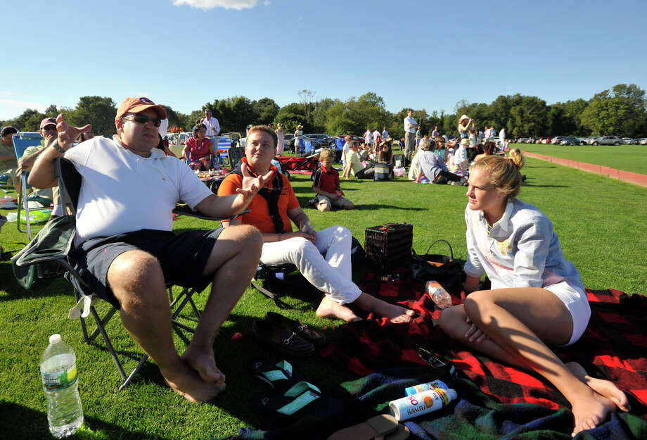 Brian McGunagle, left, Stephen Gustafson and Laura Gustafson picnic while watching the second annual Royal Salute Jubilee Cup at the Greenwich Polo Club on Sunday, Sept. 8, 2013. Photo: Jason Rearick / Stamford Advocate