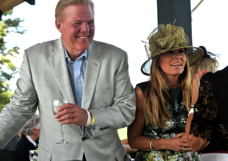 Roger Watkins and Eleni Sotiriou chat with friends during the second annual Royal Salute Jubilee Cup at the Greenwich Polo Club on Sunday, Sept. 8, 2013. Photo: Jason Rearick / Stamford Advocate