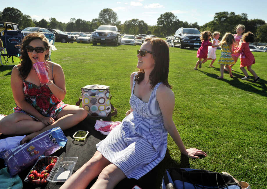BethAnne Jause, left, and Ryan Donahue picnic on the grass while watching the second annual Royal Salute Jubilee Cup at the Greenwich Polo Club on Sunday, Sept. 8, 2013. Photo: Jason Rearick / Stamford Advocate