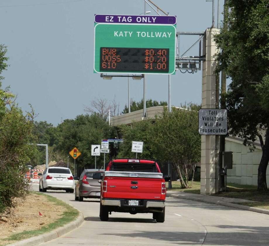 Motorists near an entrance to the Katy Managed Lanes near the METRO Addicks Park and Ride. Photo: James Nielsen, Staff / © 2013  Houston Chronicle