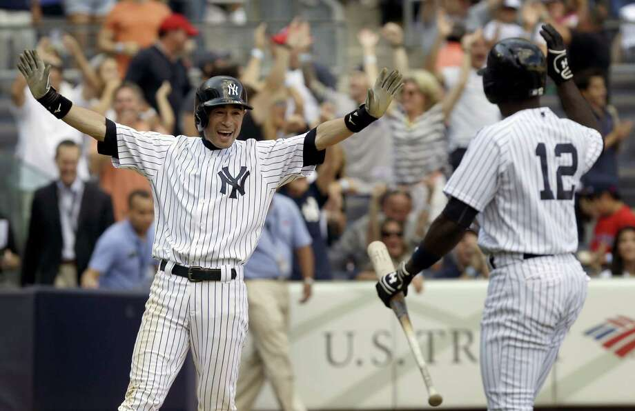 New York Yankees' Ichiro Suzuki, left, reacts after scoring on a wild pitch to win a baseball game during the ninth inning against the Boston Red Sox at Yankee Stadium, Sunday, Sept. 8, 2013 in New York. The Yankees won 4-3. (AP Photo/Seth Wenig) ORG XMIT: NYY113 Photo: Seth Wenig / AP