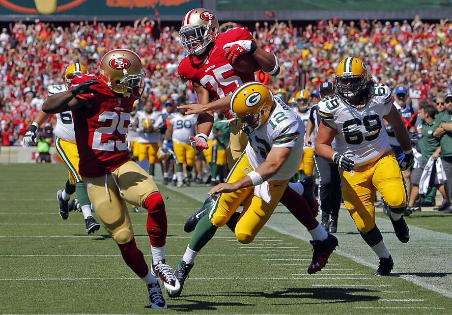 Aaron Rogers upends Eric Reid after Reid intercepted a Green Bay pass in the second quarter. The run back was overturned after replay showed Reid had been touched when he was on the ground after the interception. The San Francisco 49ers played the Green Bay Packers at Candelstick Park in San Francisco, Calif, on Sunday, September 8, 2013. Photo: Carlos Avila Gonzalez, The Chronicle
