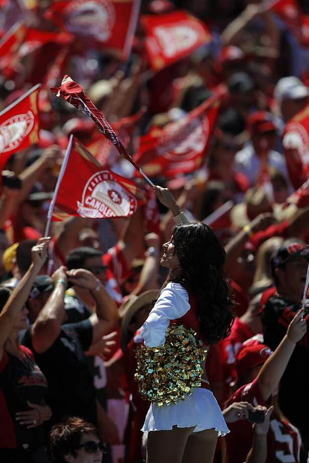 A 49ers Gold Rush girl leads the crowd in a cheer in the first quarter. The San Francisco 49ers played the Green Bay Packers at Candelstick Park in San Francisco, Calif, on Sunday, September 8, 2013. Photo: Carlos Avila Gonzalez, The Chronicle