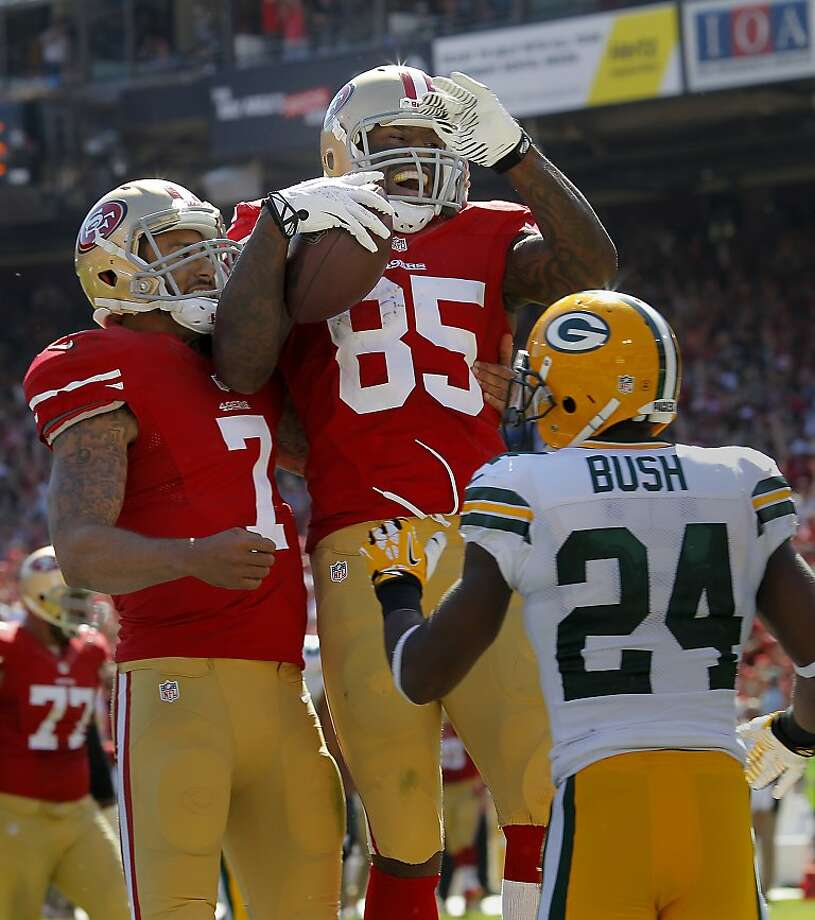 Vernon Davis (85) celebrated his second touchdown with Colin Kaepernick (7)in the third quarter Sunday September 8, 2013. The San Francisco 49ers open their 2013 season with a 34-28 victory against the Green Bay Packers at Candlestick Park in San Francisco, Calif. Photo: Brant Ward, The Chronicle