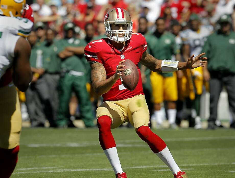 Colin Kaepernick changed direction on a run in the first half Sunday September 8, 2013. The San Francisco 49ers open their 2013 season with a 34-28 victory against the Green Bay Packers at Candlestick Park in San Francisco, Calif. Photo: Brant Ward, The Chronicle
