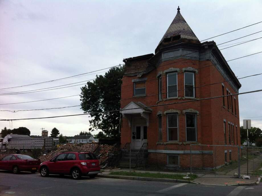 This brick rowhouse at 520 23rd St., Watervliet is the last building standing Saturday, Sept. 7, 2013, on the site where a Price Chopper Supermarket will be built. It's part of the former St. Patrick's Church site. (Kenneth C. Crowe II/Times Union)