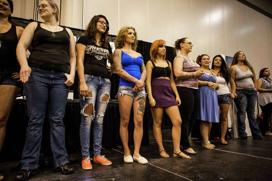 "Participants of the ""Hot Babe Contest"" line up while the emcee explains the rules during the Body Art Expo at the Reliant Center Saturday September 7, 2013. Photo: Michael Starghill, Jr. / © 2013 Michael Starghill, Jr."