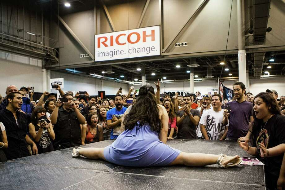 "A pregnant Elida Galvan of Houston dances for the crowd during the ""Hot Babe Contest"" at the Body Art Expo at the Reliant Center Saturday September 7, 2013. Photo: Michael Starghill, Jr. / © 2013 Michael Starghill, Jr."
