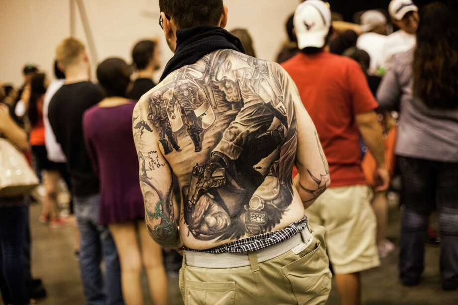 Rafael Ulloa of Orlando, FL shows off a large back tattoo during the Body Art Expo at the Reliant Center Saturday September 7, 2013. Ulloa's tattoo was done in two sessions and took 24 total hours to complete. Photo: Michael Starghill, Jr. / © 2013 Michael Starghill, Jr.