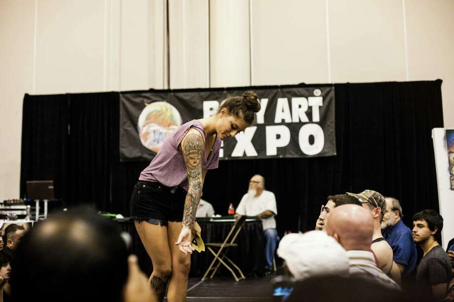 "A patron shows off her tattoos during a ""Best Tattoo Contest"" at the Body Art Expo at the Reliant Center Saturday September 7, 2013. Photo: Michael Starghill, Jr. / © 2013 Michael Starghill, Jr."