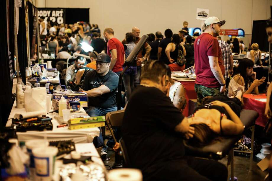 Tattoo artists and patrons pack the Reliant Center during the Body Art Expo Saturday September 7, 2013. Photo: Michael Starghill, Jr. / © 2013 Michael Starghill, Jr.
