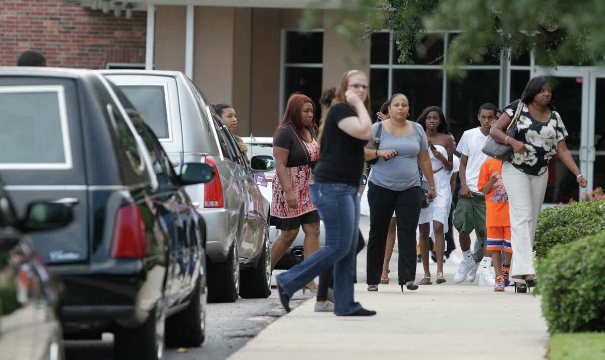 People arrive to memorial service for Joshua Broussard at Spring Baptist Church, 1027 Spring Cypress Rd., Sunday, Sept. 8, 2013, in Spring. Joshua Broussard, 17, a Spring High School student was fatally stabbed and three others injured at the school Wednesday, Sept. 3, 2013. Luis Alonzo Alfaro, 17, has been charged with murder.