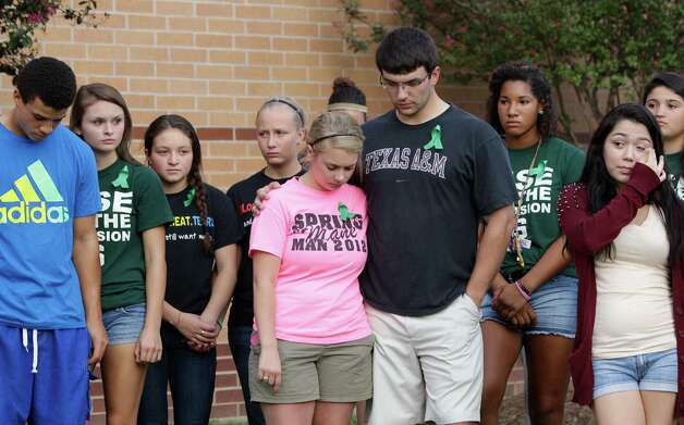 More than 200 people gathered for prayers outside Spring High School Sunday, Sept. 8, 2013, in Spring. Students will return to classes on Monday to the school where Joshua Broussard, 17, a Spring High School student was fatally stabbed and three others injured at the school Wednesday, Sept. 3, 2013.  Luis Alonzo Alfaro, 17, has been charged with murder. Photo: Melissa Phillip, Houston Chronicle / © 2013  Houston Chronicle