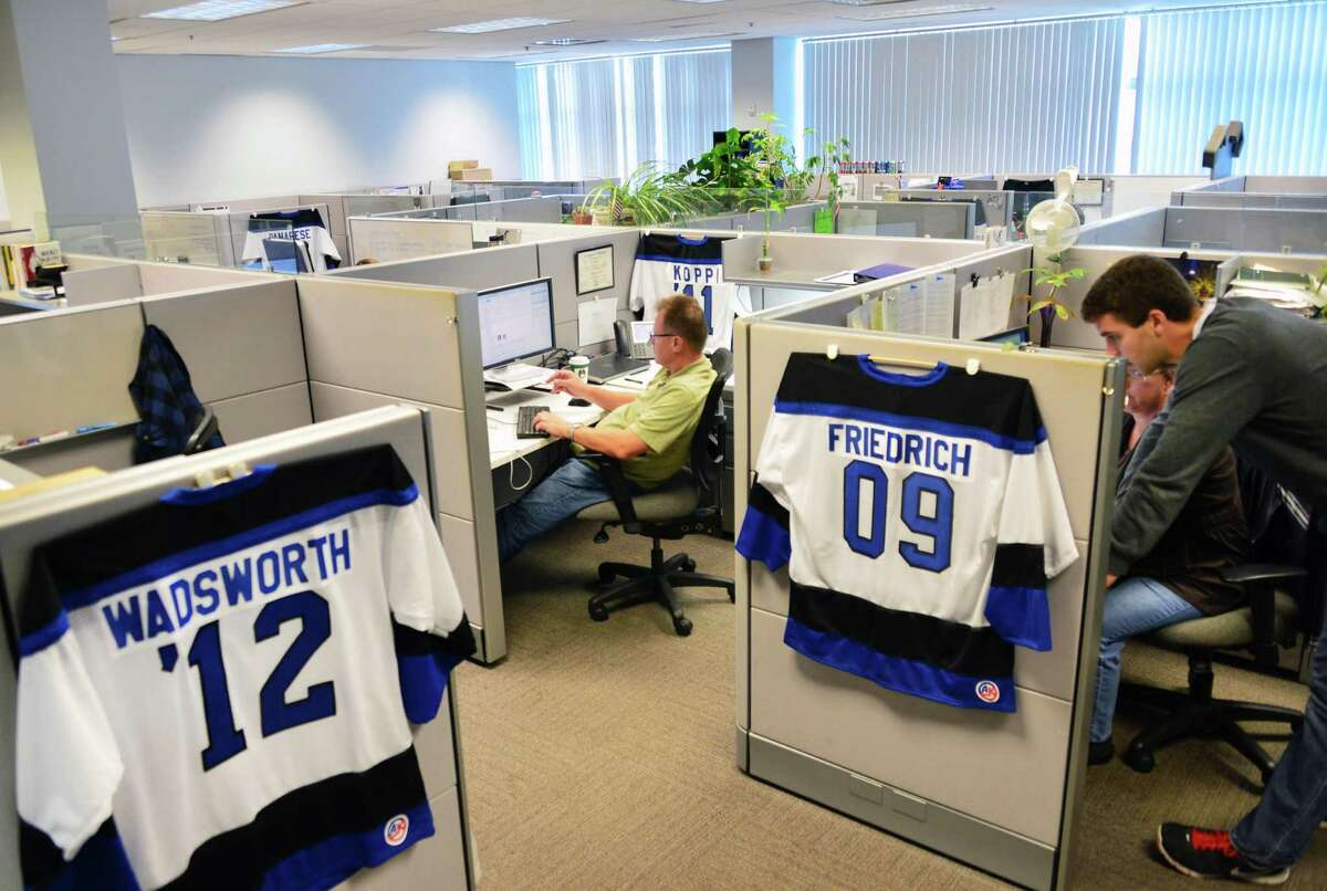 CommerceHub cubicles with employee jerseys Thursday, Sept. 5, 2013, in Albany, N.Y. (John Carl D'Annibale / Times Union)