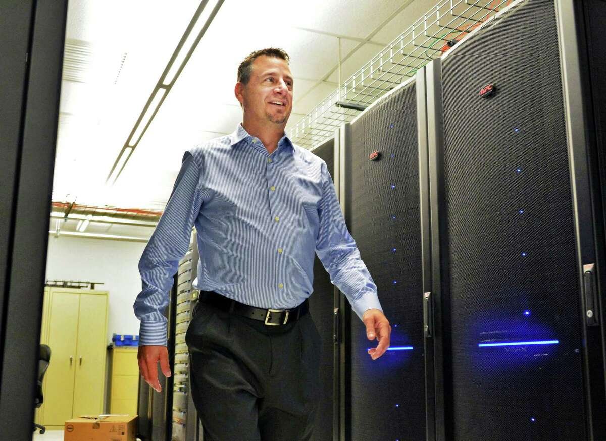 CommerceHub founder and CEO Frank Poore walks through data center storage racks Thursday, Sept. 5, 2013, in Albany, N.Y. (John Carl D'Annibale / Times Union)