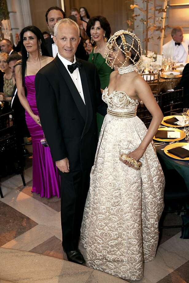 Phil Pemberton and his wife Deepa Pakianathan watch performers entertain guests just before the 91st San Francisco Season-Opening Opera Gala dinner in San Francisco Calif. on Friday, Sept. 6, 2013. Photo: Alex Washburn, Special To The Chronicle