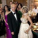 Phil Pemberton and his wife Deepa Pakianathan watch performers entertain guests just before the 91st San Francisco Season-Opening Opera Gala dinner in San Francisco Calif. on Friday, Sept. 6, 2013.