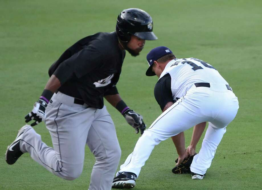 The Missions scored two runs on the throwing error by Hooks pitcher David Rollins (R) who firled  roller in front of the pitchers mound and threw wildly past first base allowing two runs to score and capped a 3-0 first inning lead over the Hooks Photo: George Tuley