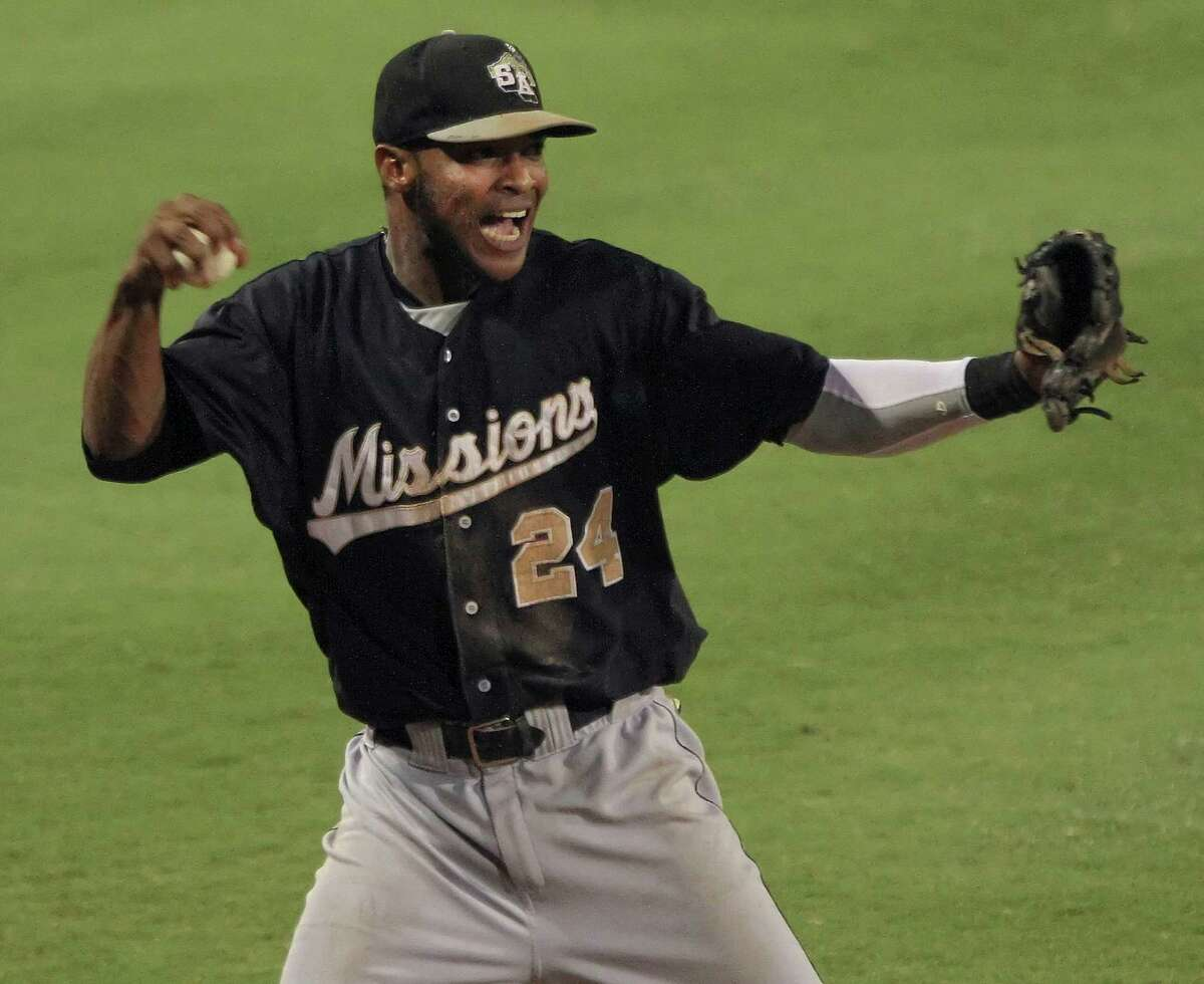 Missions' shortstop Jeudy Valdez celebrates his hustling catch of a foul ball up against the third base seats to end the game with two runners on base for a 5-3 playoff series win.