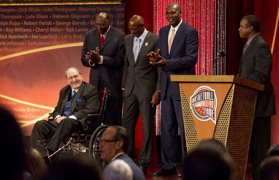 Next to his former players, Elvin Hayes, Clyde Drexler and Hakeem Olajuwon, University of Houston coach Guy V. Lewis is introduced during the Naismith Memorial 2013 Hall of Fame Enshrinement Ceremony. Photo: Johnny Hanson, Houston Chronicle