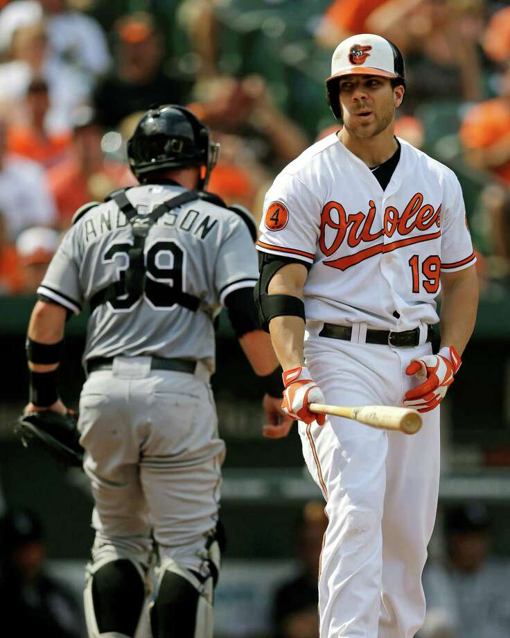 Baltimore Orioles' Chris Davis, right, reacts after striking out swinging to end the third inning of a baseball game against the Chicago White Sox, Sunday, Sept. 8, 2013, in Baltimore. (AP Photo/Patrick Semansky) ORG XMIT: MDPS107 Photo: Patrick Semansky / AP
