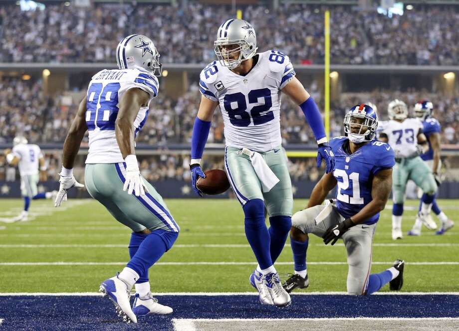 Dallas Cowboys' Dez Bryant (from left) celebrates with teammate Jason Witten after Witten scored a touchdown around New York Giants' Ryan Mundy during second half action Sunday Sept. 8, 2013 at AT&T Stadium in Arlington, Tx. Photo: San Antonio Express-News