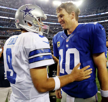 Dallas Cowboys' Tony Romo (left) talks with New York Giants' Eli Manning after the game Sunday Sept. 8, 2013 at AT&T Stadium in Arlington, Tx. The Cowboys won 36-31. Photo: Edward A. Ornelas, San Antonio Express-News / © 2012 San Antonio Express-News