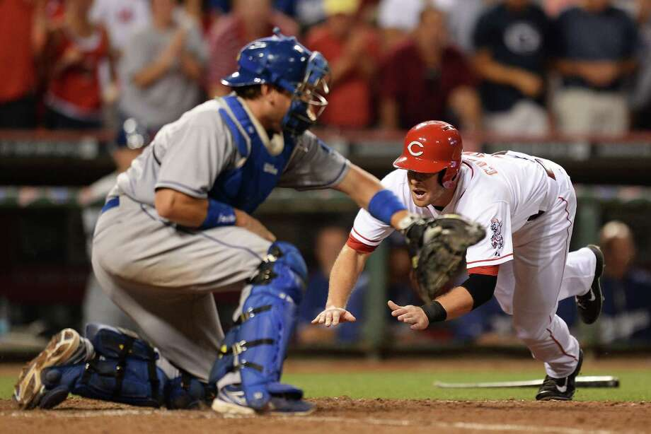 Zack Cozart beats the throw to Dodgers catcher A.J. Ellis to complete the Reds' weekend sweep. Photo: Jamie Sabau, Stringer / 2013 Getty Images