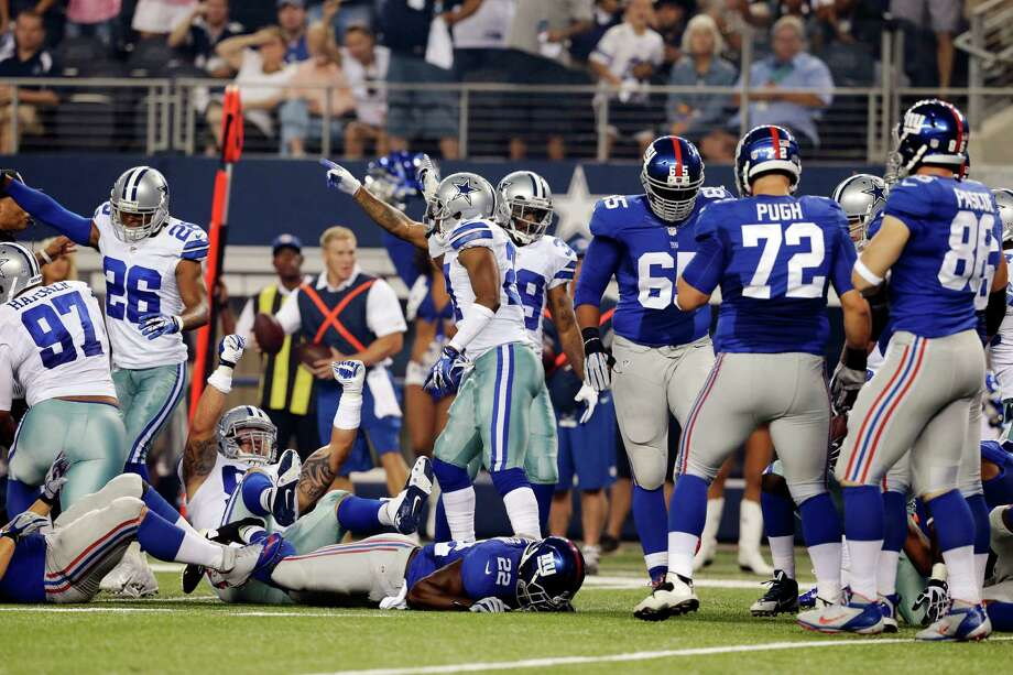 The Dallas Cowboys celebrate a fumble by New York Giants running back David Wilson (22) during the first half of an NFL football game, Sunday, Sept. 8, 2013, in Arlington, Texas. (AP Photo/LM Otero) ORG XMIT: CBS120 Photo: LM Otero / AP