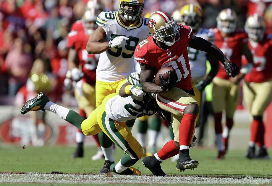 San Francisco 49ers wide receiver Anquan Boldin (81) runs past Green Bay Packers defensive back Jerron McMillian (22) during the fourth quarter of an NFL football game in San Francisco, Sunday, Sept. 8, 2013. The 49ers won 34-28. (AP Photo/Ben Margot) ORG XMIT: FXP136 Photo: Ben Margot / AP