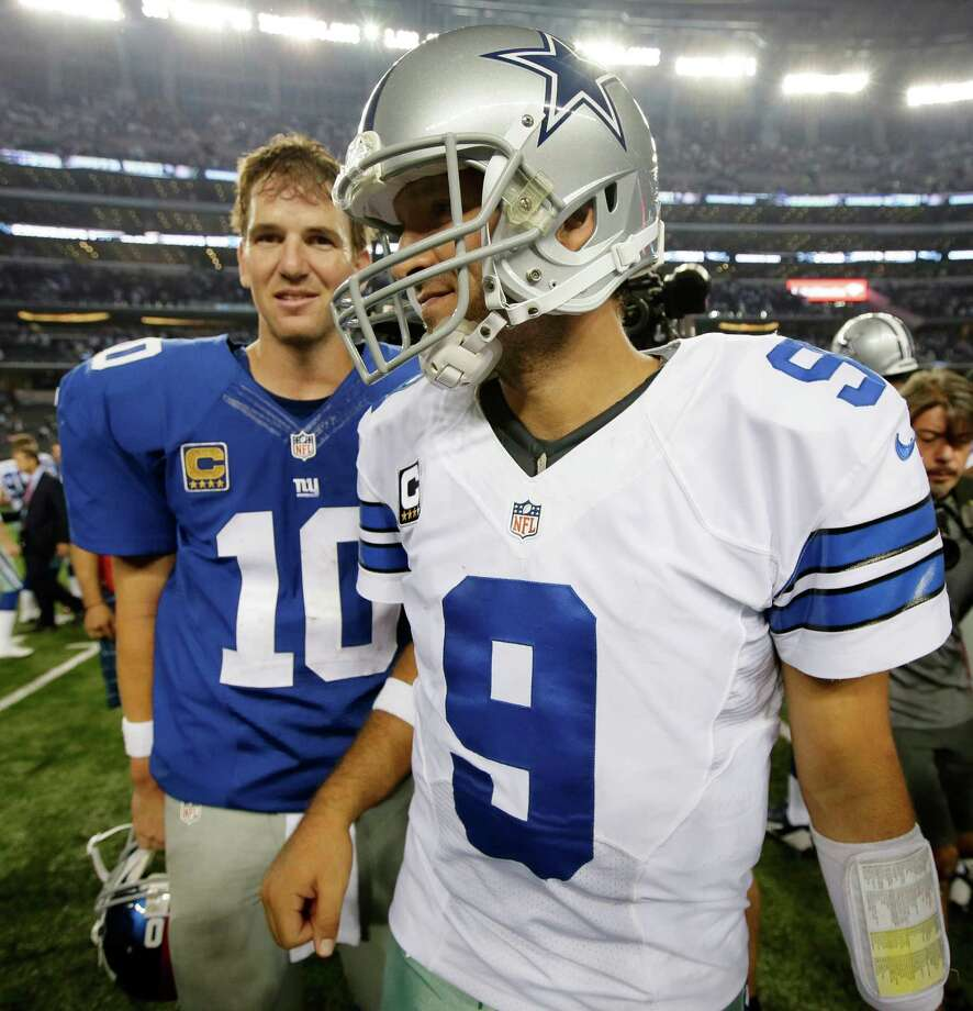 New York Giants quarterback Eli Manning (10) and Dallas Cowboys quarterback Tony Romo (9) leave the field after the Cowboys won an NFL football game 36-31 on Sunday, Sept. 8, 2013, in Arlington, Texas. (AP Photo/Tony Gutierrez) Photo: Tony Gutierrez, Associated Press / AP
