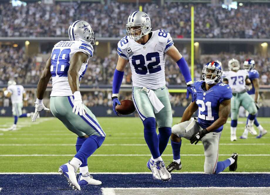 Dez Bryant (left) and tight end Jason Witten celebrate one of Witten's two touchdowns as the Giants' Ryan Mundy (21) looks on. Photo: Edward A. Ornelas / San Antonio Express-News
