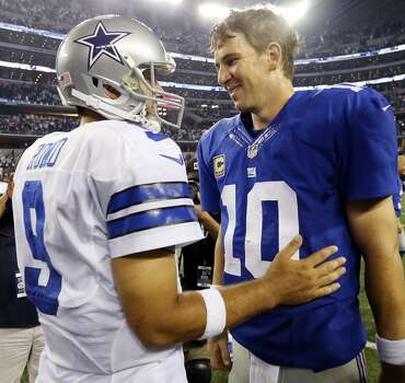 Dallas Cowboys' Tony Romo (left) talks with New York Giants' Eli Manning after the game Sunday Sept. 8, 2013 at AT&T Stadium in Arlington, Tx. The Cowboys won 36-31. Photo: Edward A. Ornelas, San Antonio Express-News