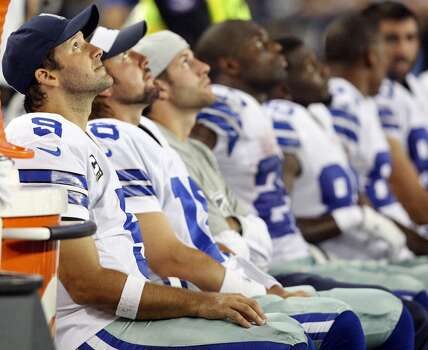 Dallas Cowboys' Tony Romo (left) and teammates watch second half action against the New York Giants from the bench Sunday Sept. 8, 2013 at AT&T Stadium in Arlington, Tx. The Cowboys won 36-31. Photo: San Antonio Express-News