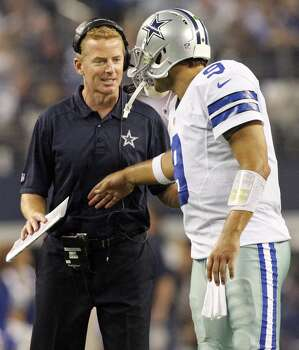 Dallas Cowboys head coach Jason Garrett (left) talks with Tony Romo during second half action against the New York Giants Sunday Sept. 8, 2013 at AT&T Stadium in Arlington, Tx. Photo: San Antonio Express-News