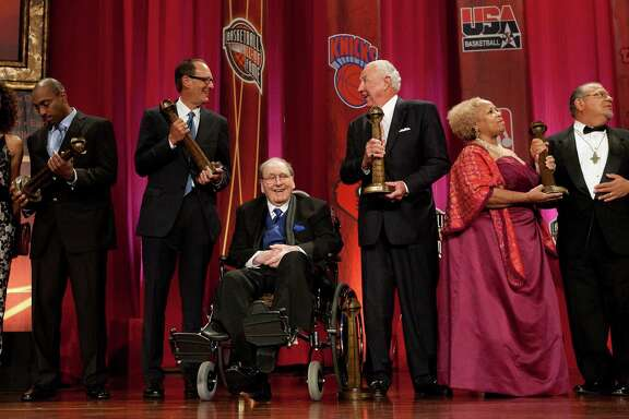 University of Houston coach, Guy V. Lewis holds his Naismith Basketball Hall of Fame trophy next to fellow inductees, Russ Granik, left, and Richie Guerin after he was inducted into the 2013 Basketball Hall of Fame at the Springfield Symphony Hall Sunday, Sept. 8, 2013, in Springfield. ( Johnny Hanson / Houston Chronicle )