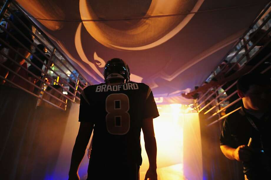 ST. LOUIS, MO - SEPTEMBER 8: Sam Bradford #8 of the St. Louis Rams is introduced before a game against the Arizona Cardinals at the Edward Jones Dome on September 8, 2013 in St. Louis, Missouri.  (Photo by Michael Thomas/Getty Images) Photo: Michael Thomas, Getty Images
