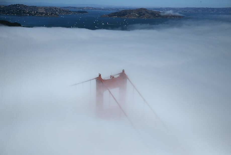 SAN FRANCISCO, CA - SEPTEMBER 08:  The south tower of the Golden Gate Bridge peeks through fog on September 8, 2013 in San Francisco, California.  (Photo by Justin Sullivan/Getty Images) Photo: Justin Sullivan, Getty Images