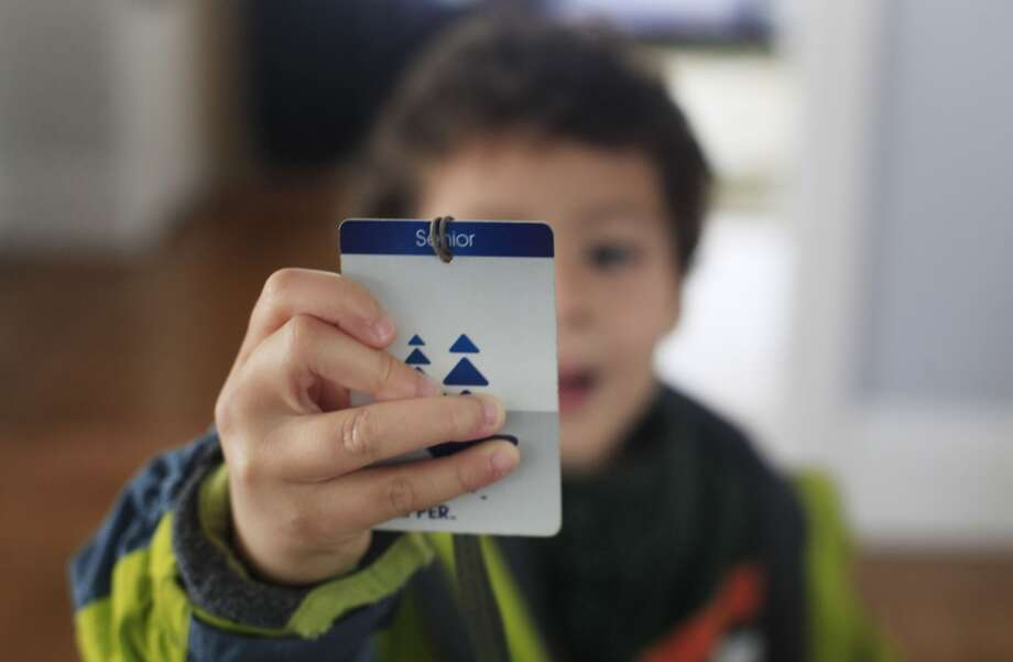 Excited to rid the MUNI, Ben Easter, 4, holds his grandmother's Clipper card at home in San Francisco, Calif. Photo: Mike Kepka, The Chronicle