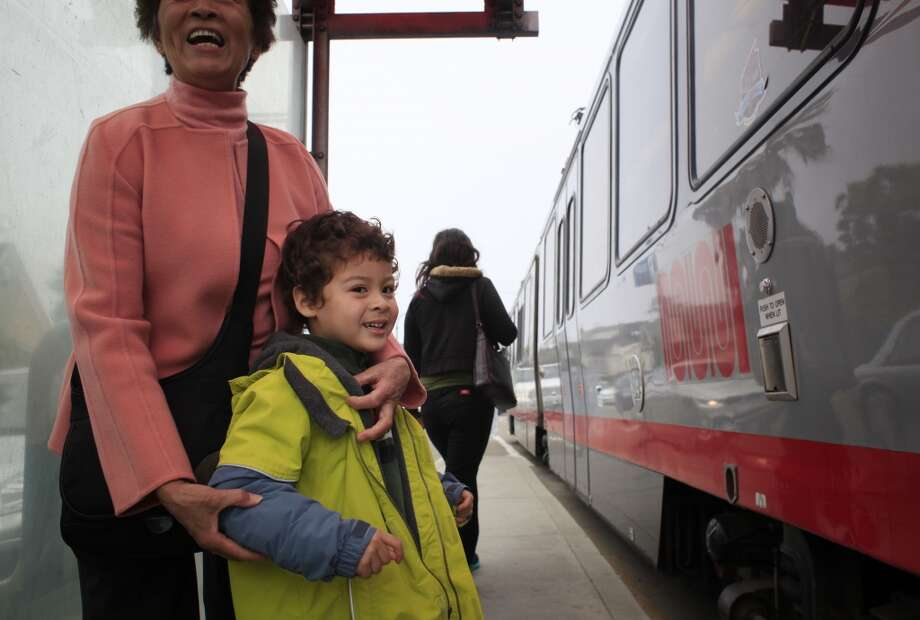 Ben Easter, 4, and his grandmother Maria Kwan wait as the K train pulls in front of them on Ocean Avenue in San Francisco, Calif. Photo: Mike Kepka, The Chronicle
