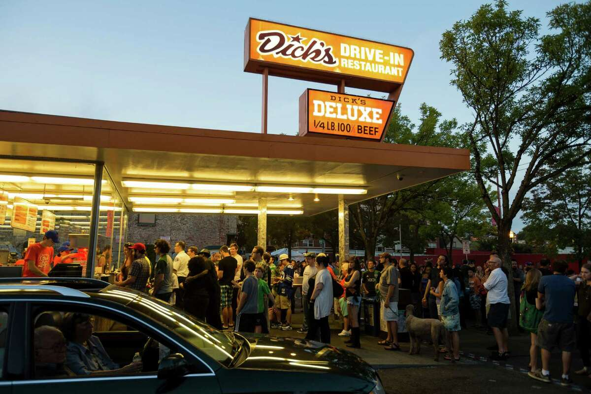Attendees line up for burgers during the Dick's Drive-In 60th Anniversary Broadway Block Party on Sunday in the Capitol Hill neighborhood of Seattle. The all-day event boasted beers from a number of brewers and a host of live, local music.