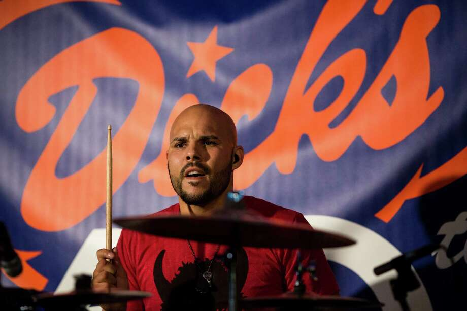 Ayron Jones and The Way perform during the Dick's Drive-In 60th Anniversary Broadway Block Party on Sunday in the Capitol Hill neighborhood of Seattle. The all-day event boasted beers from a number of brewers and a host of live, local music. Photo: JORDAN STEAD, SEATTLEPI.COM / SEATTLEPI.COM