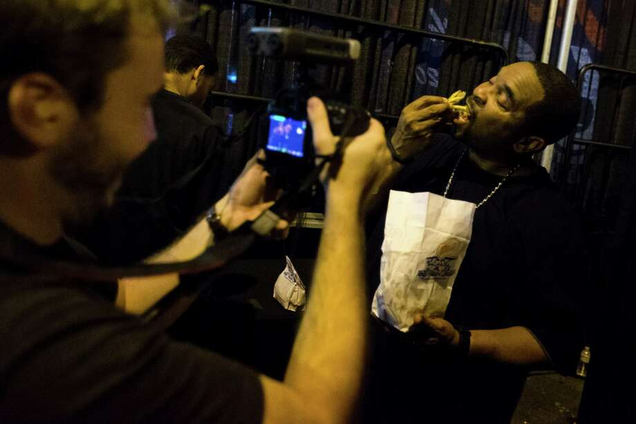 Sir Mix-a-Lot chows down on fries for the camera following his performance at the Dick's Drive-In 60th Anniversary Broadway Block Party on Sunday in the Capitol Hill neighborhood of Seattle. The all-day event boasted beers from a number of brewers and a host of live, local music. Photo: JORDAN STEAD, SEATTLEPI.COM / SEATTLEPI.COM