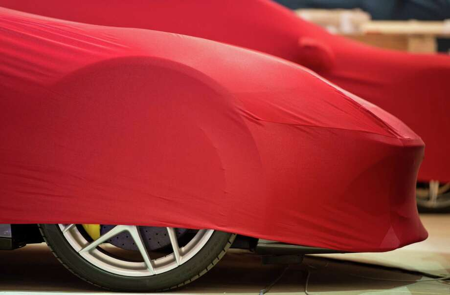 Veiled Ferrari cars wait on the grounds  during preparations for 65th Frankfurt Auto Show in Frankfurt, Germany, Sunday Sept. 8, 2013. Photo: Dpa,Boris Roessler