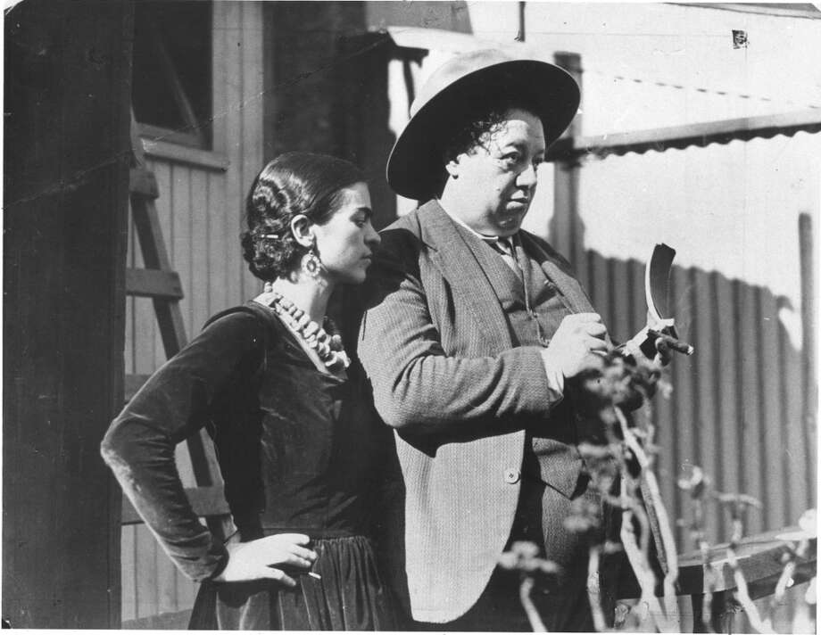 Claim: Diego Rivera painted a mural in Coit Tower (the artist is seen here sketching S.F. with his wife Freida Kahlo). Photo: Chronicle File Photo
