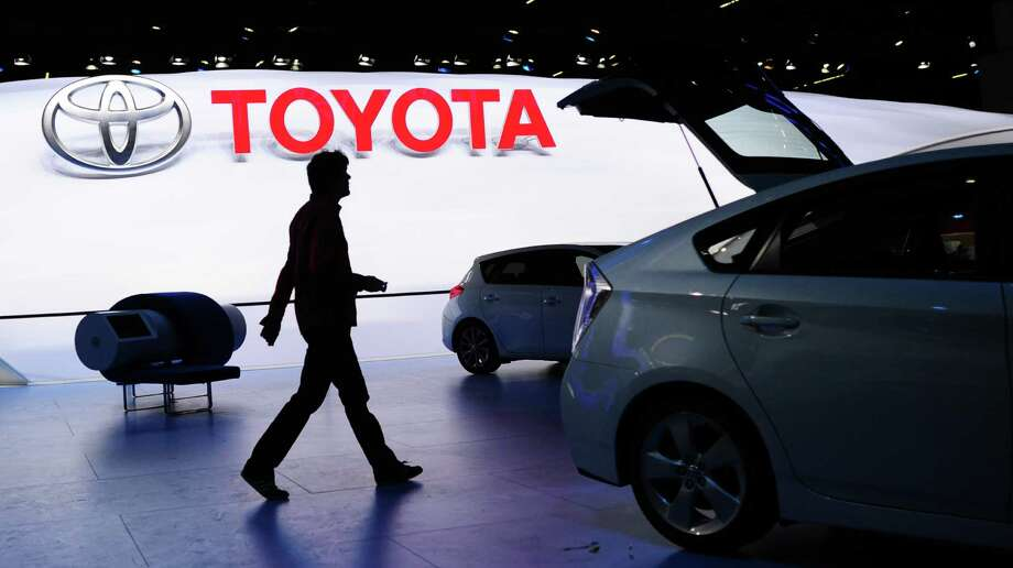 A man walks at the Toyota booth during preparations for  the International Motor Show IAA in Frankfurt  Germany,Sunday Sept. 8, 2013. The 65th  IAA  features  more than 1,000  exhibitors from around the world and takes place from Sept. 12 to  Sept. 22 , 2013. Photo: Dpa,Boris Roessler